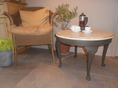 A hand finished occasional table hand finished and slightly distressed with a crackle top.