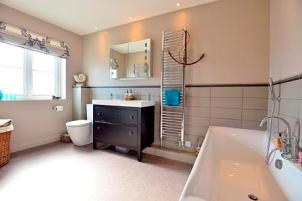 Double basin, bath and toilet in large bathroom