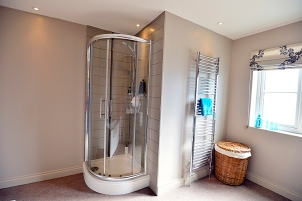 Shower and duel fuel chrome towel rail in bathroom
