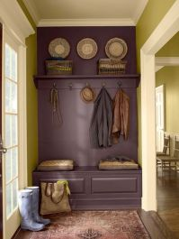 By painting the wall, seat and shelf the same colour it creates an illusion of a large settle.