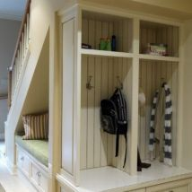 Clever use of under stairs space has been used in this hall.