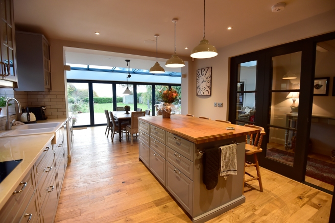 Open plan kitchen/diner/day room with bi-fold doors onto garden.