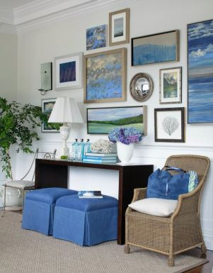 A mixture of pictures, mirrors and artwork with a common colour blue, blend in with the rooms decor.