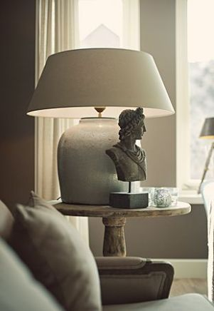 A well positioned ornament next to a lamp adds interest and texture.
