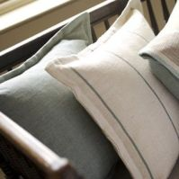 Simple grey and grey stripe cushions creates a calm ambiance. Roger Oates