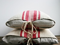 Contrasting striped old grain sacks tied with cord