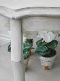 Vintage, painted furniture sits well in a conservatory or garden room. (Sarah Maidment Interiors)