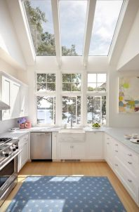Light floods into this glass extension used for a kitchen