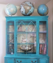 A display of globes compliment the cabinet