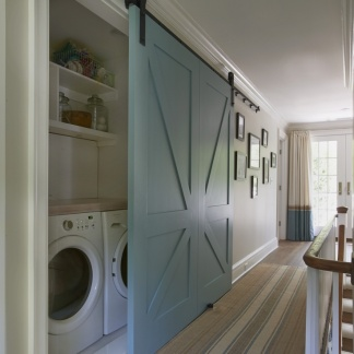 Utility area hidden by sliding doors