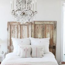 A chandelier is a must in a French bedroom