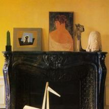 Saffron Yellow contrasts well with the dark fireplace