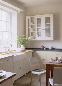 Warm white's used in this kitchen. Units from Plain English