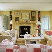 Light yellow walls with reds. Vanessa Arbuthnott