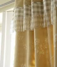 Fringe yellow curtains with a complimentary grey. Vanessa Arbuthnott