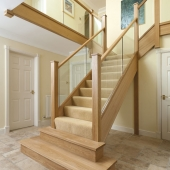 Glass balustrades open up the space. Neville Johnson