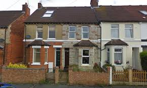 A row of terraced houses badly renovated.