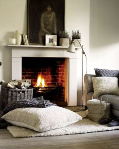 This simple fireplace and surround sits well in this room decor