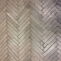 Cast concrete herringbone floor