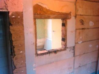 Kitchen units stripped out ready for wall removal
