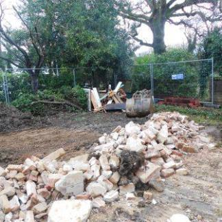 Bricks and rubble from the walls and chimney removal ready to form a base on the drive