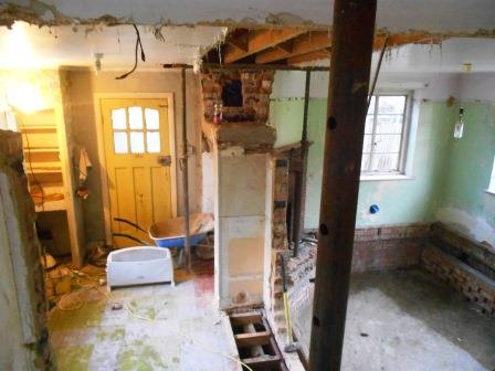 During - The wall dividing the kitchen and dining room has been removed.
