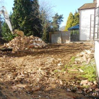 Bricks and rubble from the garage demolition, some of which will be used to form a base for the terrace