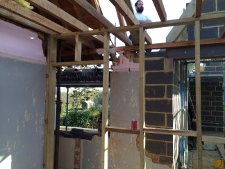 Attaching the new joists to the existing house to form one new roof