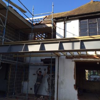 We are waiting to find out the required covering for the steel beam to take the bi- fold doors and glass roof.