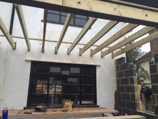 A view of the other beam for the dining room roof to support glass roof.