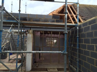 Knocking through from the existing house into the extension revealed different levels of flooring