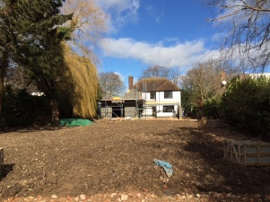 The extension growing and a bare canvas for a garden