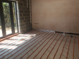 Underfloor heating pipes laid onto insulation and prior to screeding