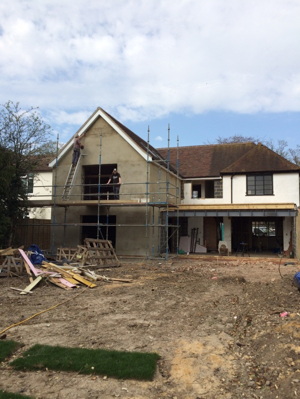 The new render on the extension being stabilised prior to painting