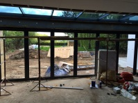 The day room showing the bi- fold doors and sloping glass roof
