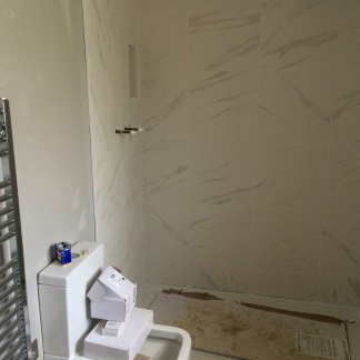Tiling in progress in shower en-suite shower area