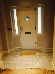 A well for the drop in foot mat incorporated in the tile design