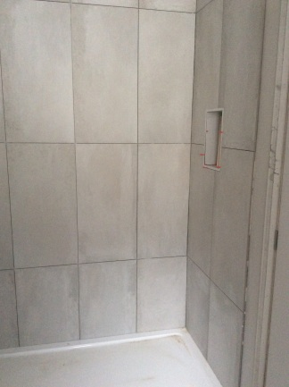 Grey grout was used to match the tiles