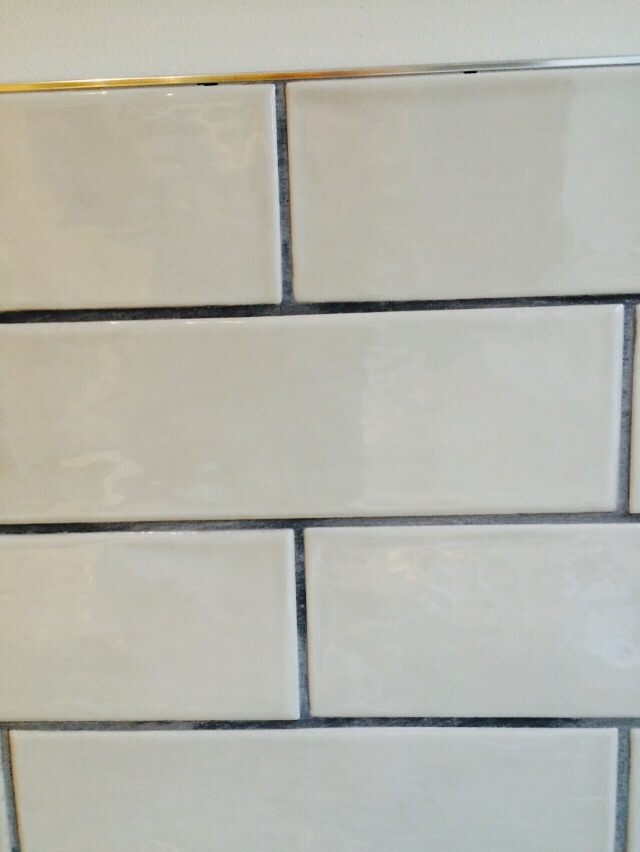 Subway tiles with grey grout and trim