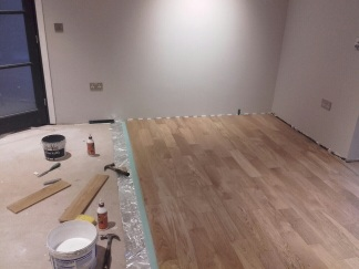 The wooden floor being laid, with the layers beneath.