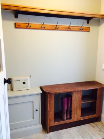 Re purposed furniture into coat and boot storage