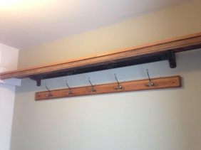 Decorative pieces of wood from the bed are now on shelves and for coat hooks