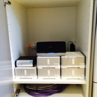 The 'coms' cupboard all connected. The bottom shelf is for Sky connection