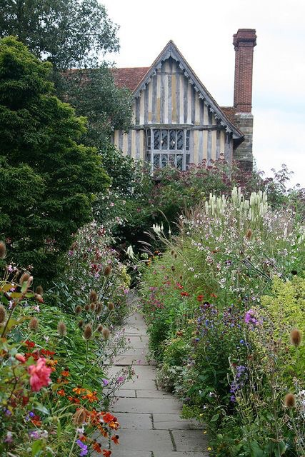 An herbaceous border blends with the house