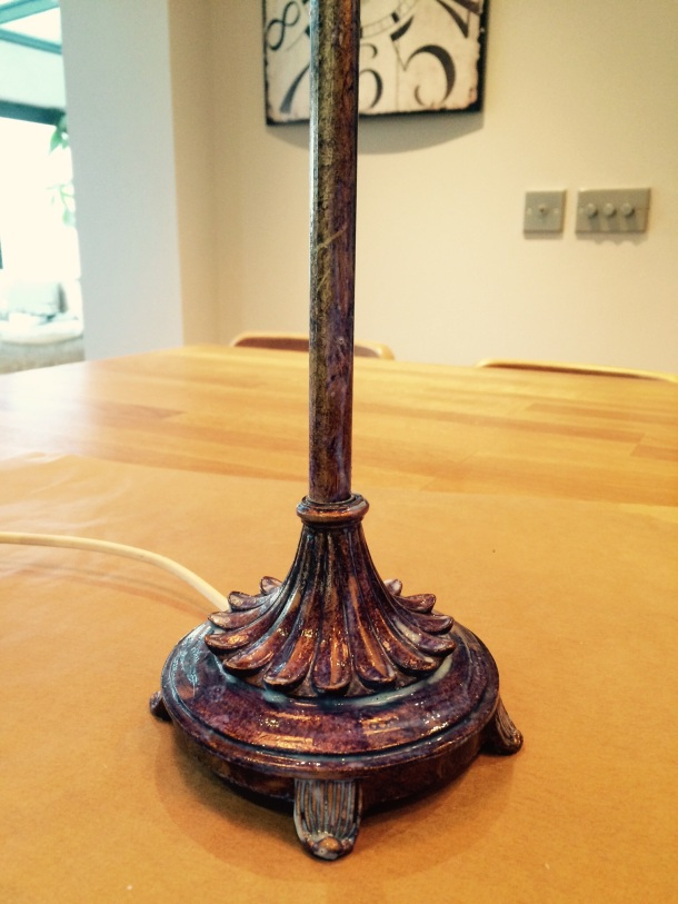 Gold size brushed onto lamp base