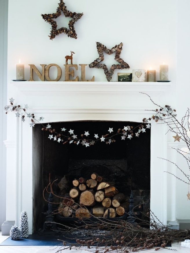 A collection of a woodland theme on a hearth for Christmas
