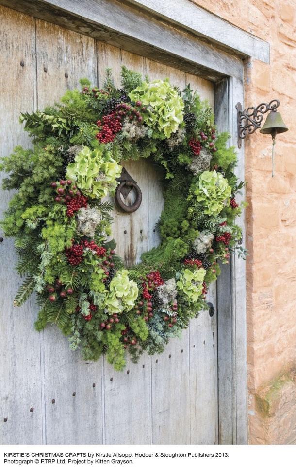An evergreen Christmas door wreath
