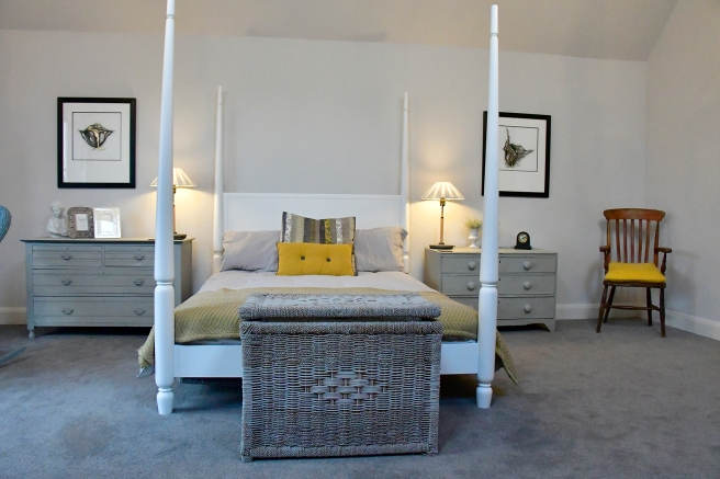master bedroom with four poster bed from Heals