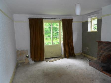 Before Original 1930's sitting room complete with Crittal French doors and brick fireplace