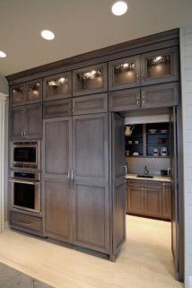 Walk in pantry adjacent to kitchen in grey
